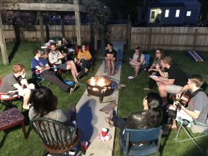 Small group outdoors around firepit circa 2018